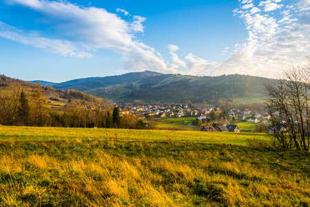 Wegierska Gorka, Poland - November 11, 2018: Residential houses in the countryside. View at sunset. Zywicki Beskids. Southern Poland.