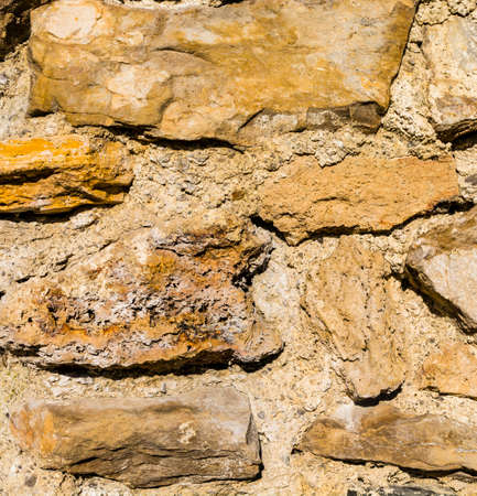 Fragment of the medieval castle wall - close-up on the textural.