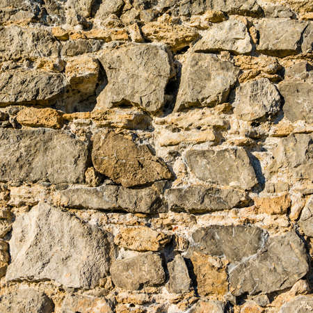 Stone castle wall from the Middle Ages - close up on the texture.