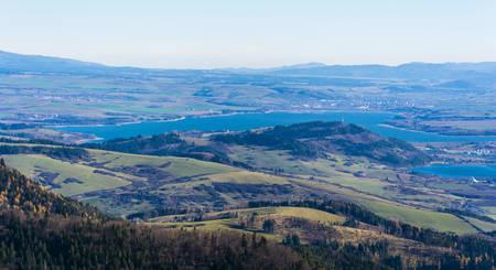 Likavka, Slovakia - November 17, 2018: Autumn view of the lake Liptovska Mara and the town Liptovsky Mikulas in northern Slovakia.
