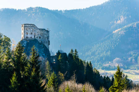 Likavka, Slovakia - November 17, 2018: Hrad Likava castle located on the rock. View of the destroyed walls towering above the forest. Redakční