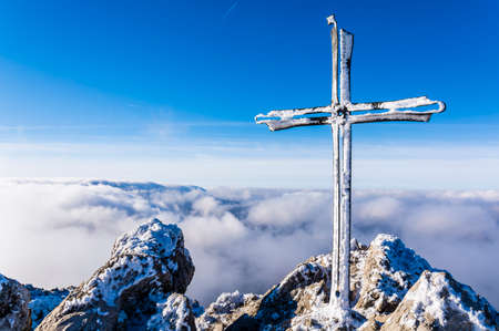 Frosted cross on a mountain peak Velky Rozsutec in Mala Fatra in Slovakia. The peak is situated in the north part of Mala Fatra (Little Fatra) called Krivanska Mala Fatra.