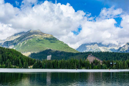 Strbske Pleso, Slovakia - September 11, 2020: Viewing tower and a characteristic hotel building by the lake Strbske pleso in the mountains of the High Tatras, Slovakia.
