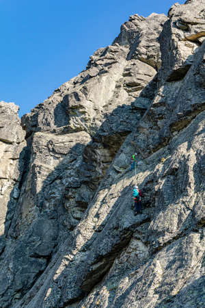Strbske Pleso, Slovakia - September 14, 2020: Mountain climbing in the Tatras - A team of climbers on the first pitch of the Staflovka road on Volia veza (Wolowa Turnia).