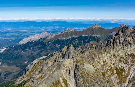 Late summer landscape of peaks and valleys seen from a peak in the Tatra Mountains, Slovakia. Zdjęcie Seryjne