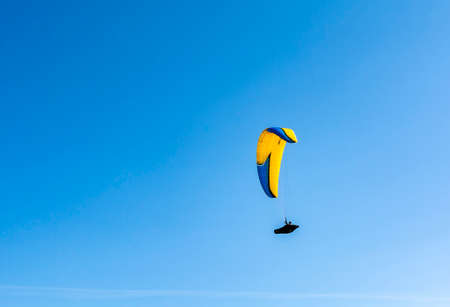 Tatranska Lomnica, Slovakia - September 15, 2020: Paragliding - The pilot lies supine in a coccoon-like - speed bag - suspended below a fabric wing.