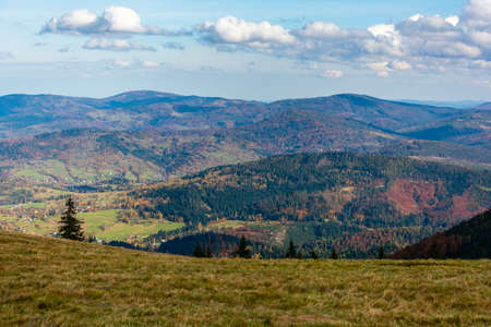 Autumn landscape of mountain hills covered with colorful forests. Zywiec Beskids. Zdjęcie Seryjne