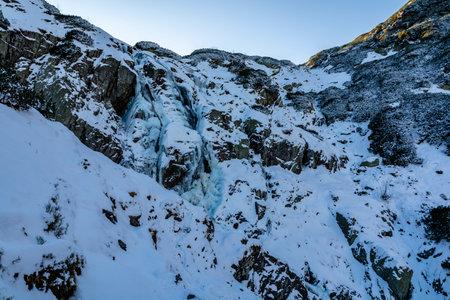Siklawa (Wielka Siklawa) - The largest waterfall in Poland in winter scenery. Tatra Mountains.