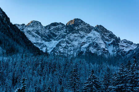 View from the north on the early winter landscape on Mieguszowiecki Summits. They are a group of three major summits in the main ridge of the Tatra Mountains on the border between Poland and Slovakia. Zdjęcie Seryjne