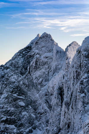 Peak Wysoka (Vysoka) - The northern wall is covered with snow rime. The peak belongs to the so-called Great Crown of the Tatra Mountains. Zdjęcie Seryjne