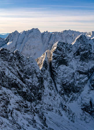 Landscape of mountain ridge in snow rime on a beautiful sunny and frosty day. Tatra Mountains.