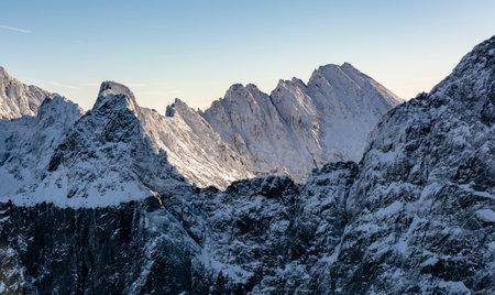Peak Ganek (Ganok) with Galeria Gankowa (Galeria Ganku) and ridge - Gran Konczystej (hreben Koncistej) in winter scenery. Tatra Mountains.