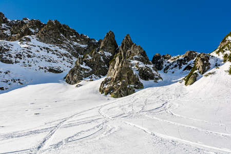 Winter mountain landscape. The snow gully is a popular place for downhill skiing by ski touring skiers.