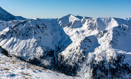 Winter mountain landscape on a beautiful sunny day in the Tatra Mountains.