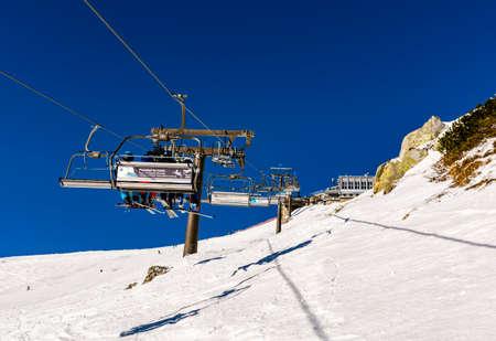 Zakopane, Poland - March 02, 2021: Skiers going by Gasienicowa chairlift (PKL) to the top of Kasprowy Wierch (Kasprov vrch). Publikacyjne