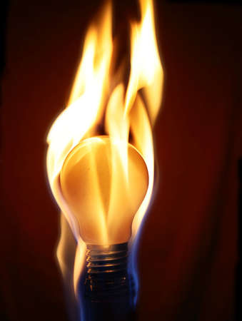 reincarnation: dark background. bulb in flames...