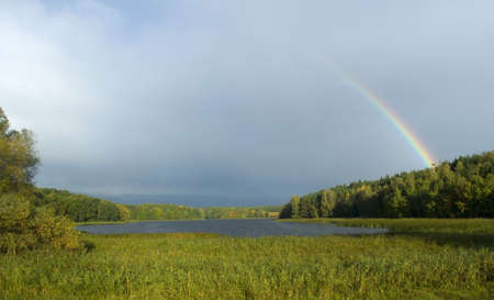 Lake and rainbow photo