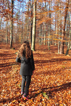 girl walk in the woods photo