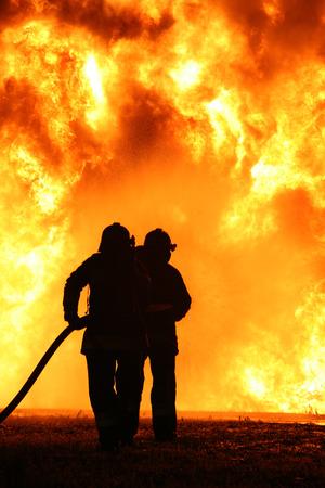 Firefighting training Фото со стока