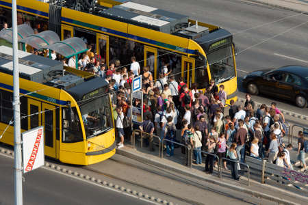 semester: Budapest, 2009: crowd of students tries to get on the tram after near the university Editorial