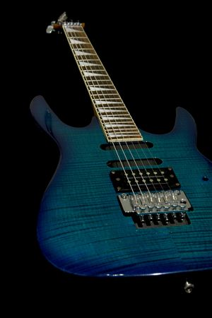 Blue electric guitar with superstrat shape isolated on black Stock Photo - 741595