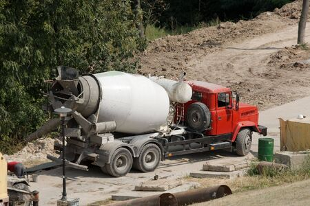 Concrete mixer truck at a construction site