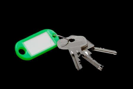 keyholder: Bunch of keys isolated on black background Stock Photo