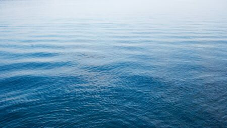 Blue water surface with small waves