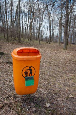 Dustbin along the path, orange color photo