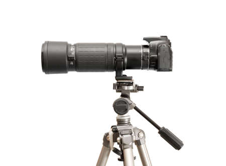 slr camera: DSLR camera with telephoto lens on a tripod