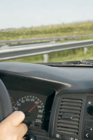Driving a car at high speed on a highway photo