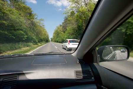 overtake: Overtaking a car viewed from inside