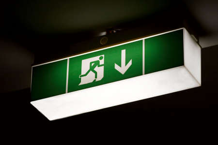 Emergency exit sign glowing in the dark Stock Photo - 4707332