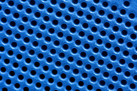 Hole pattern grid of an electronic device in blue Stock Photo - 4707334