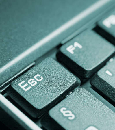 escape key: Detail of a computer keyboard focused on the escape key Stock Photo