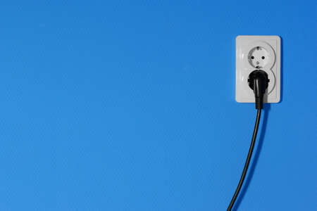 grounded plug: Electric outlets on a blue wall Stock Photo