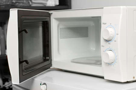 Empty microwave oven with open door photo