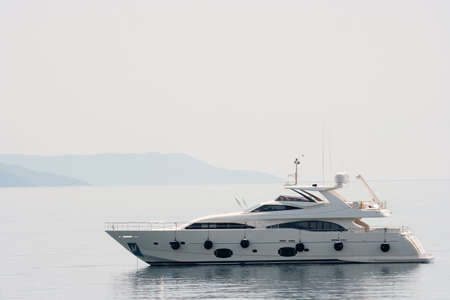 yachts: Luxury yacht on the sea in bright sunlight