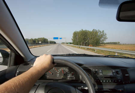 Driving a car on a highway Stock Photo - 4875046