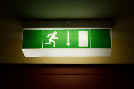 Emergency exit sign in the dark photo