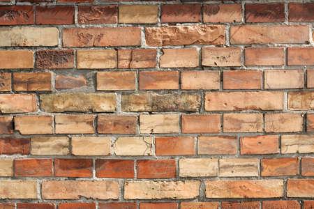 Regular brick wall background with small bricks photo