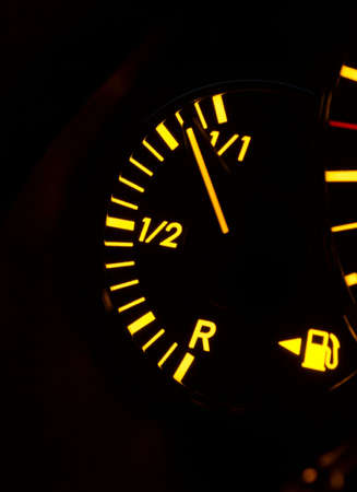 Fuel indicator on a car dashboard, tank is almost full photo