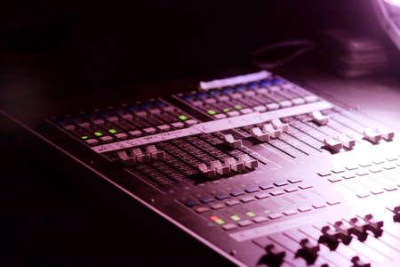 soundboard: Soundboard mixer at a concert in the dark Stock Photo