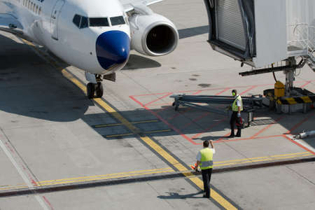 Airplane coming to its parking stand at the airport Stock Photo