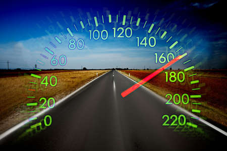 speeding car: Speedometer over a blurred road representing driving very fast