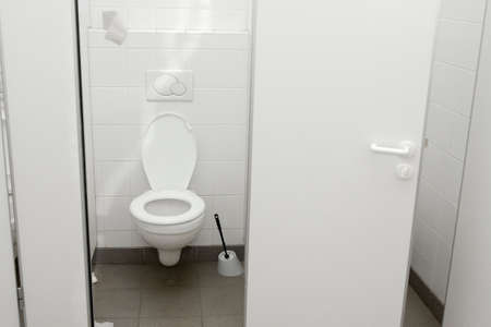 Public toilet with open door Stock Photo