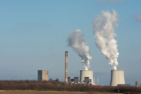 Smoke coming out of a power plant Stock Photo - 5498519