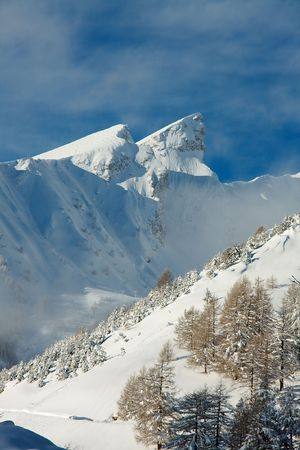 High mountains covered by snow in winter Stock Photo - 5568090
