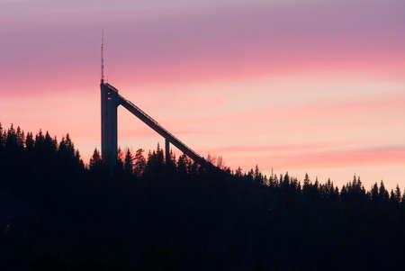 Ski jump ramp against strange colored evening sky in Finland photo