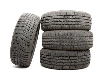 A set of tyres isolated on white background photo